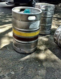 The smallest keg to play with is the one with the blue tape on the top - 125 lbs, I'm told.
